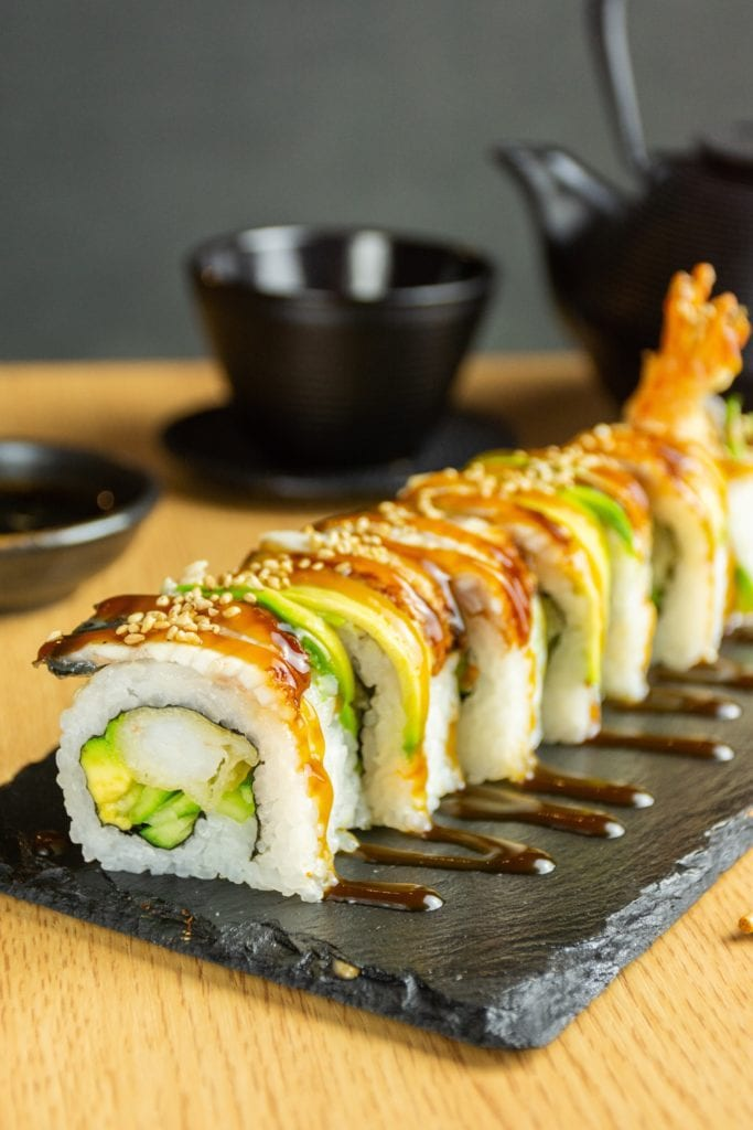 sushi on brown wooden tray